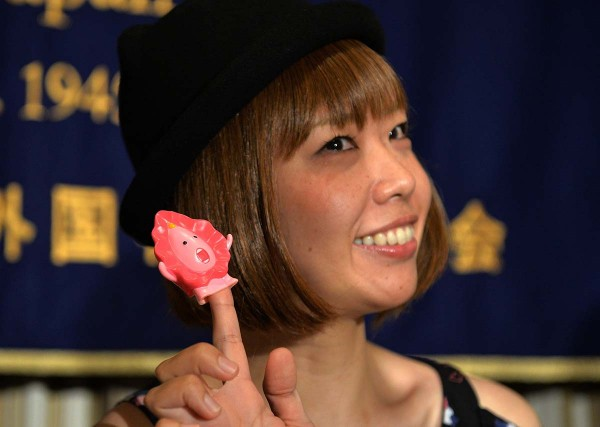 "Japanese artist Megumi Igarashi, who calls herself Rokude Nashiko, shows a small mascot shaped like a vagina ""Manko-chan"" at a news conference in Tokyo on July 24, 2014. Igarashi, who has created genital-inspired artworks and was arrested on obscenity charges last week, was released from police custody on July 18, a case which supporters said was an attack on free expression. AFP PHOTO / Yoshikazu TSUNO (Photo credit should read YOSHIKAZU TSUNO/AFP/Getty Images)"
